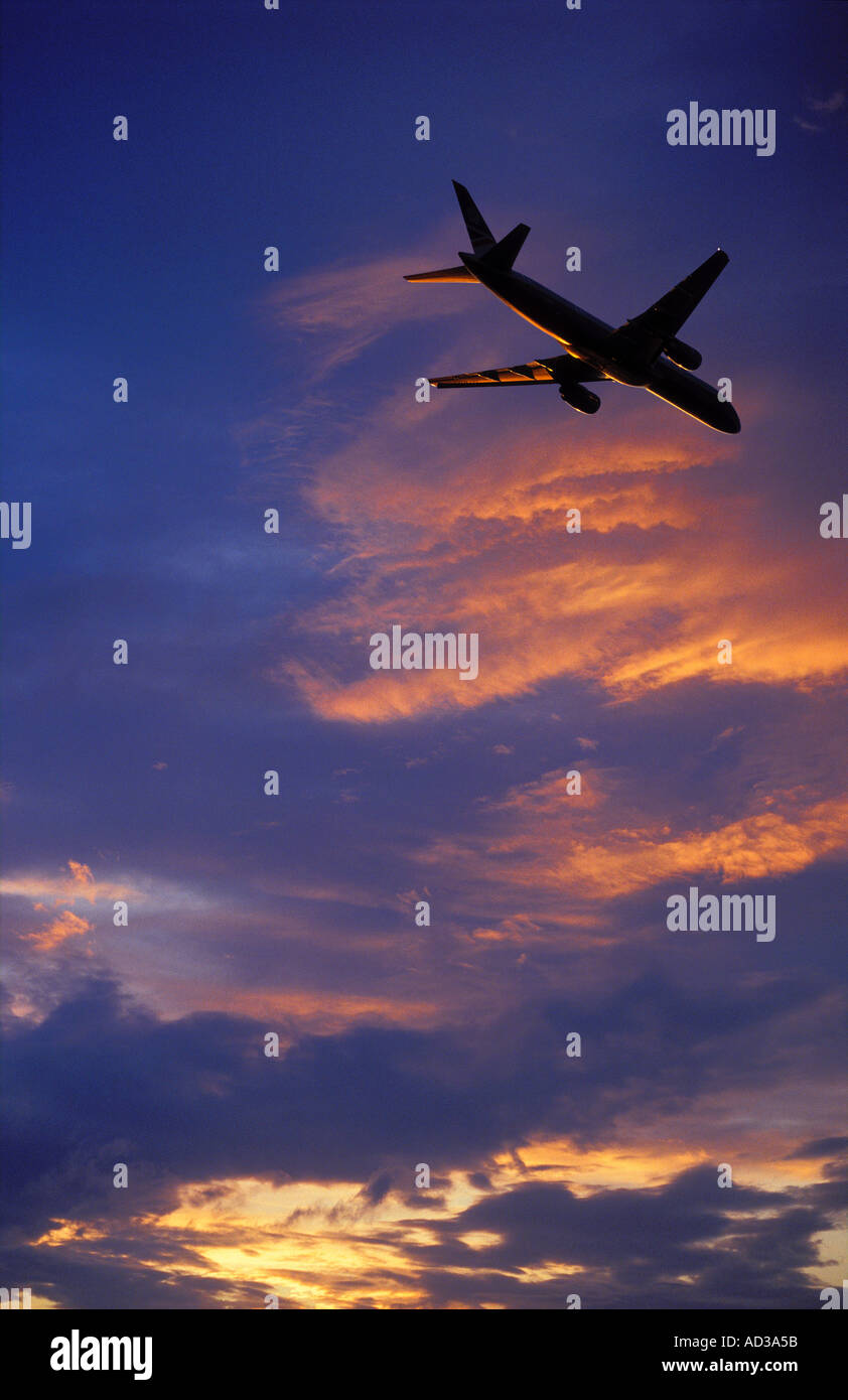 Plane in Flight Heathrow England UK - Stock Image