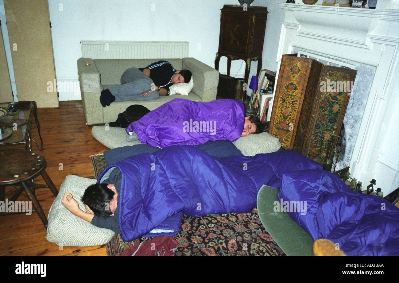 Young People Sleeping On The Floor Over At Each Other S