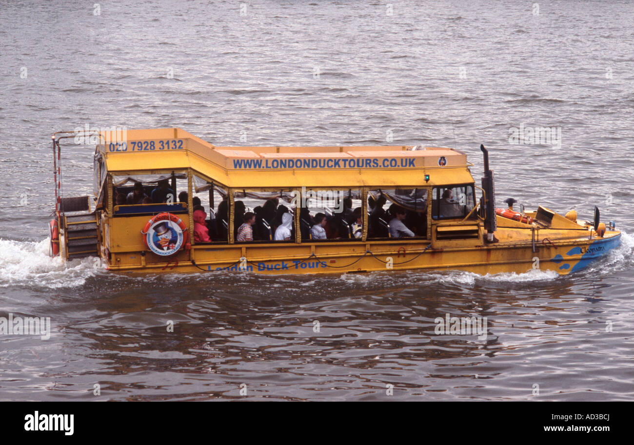 London Duck Tours amphibious landing craft with tourists on River Thames at Westminster, London, England - Stock Image