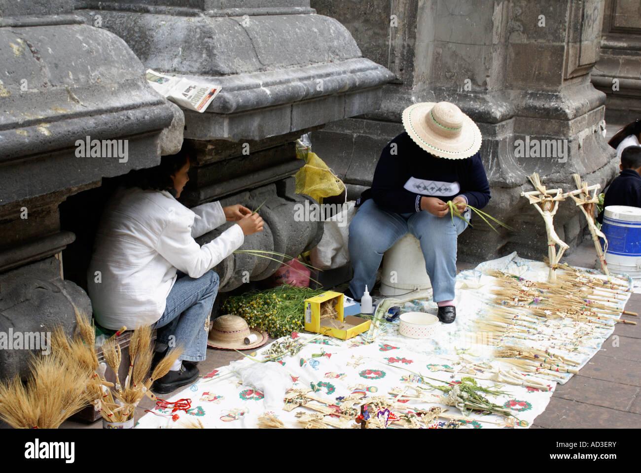 Palm Sunday sidewalk Vendors selling straw crucifixes, Mexico City - Stock Image