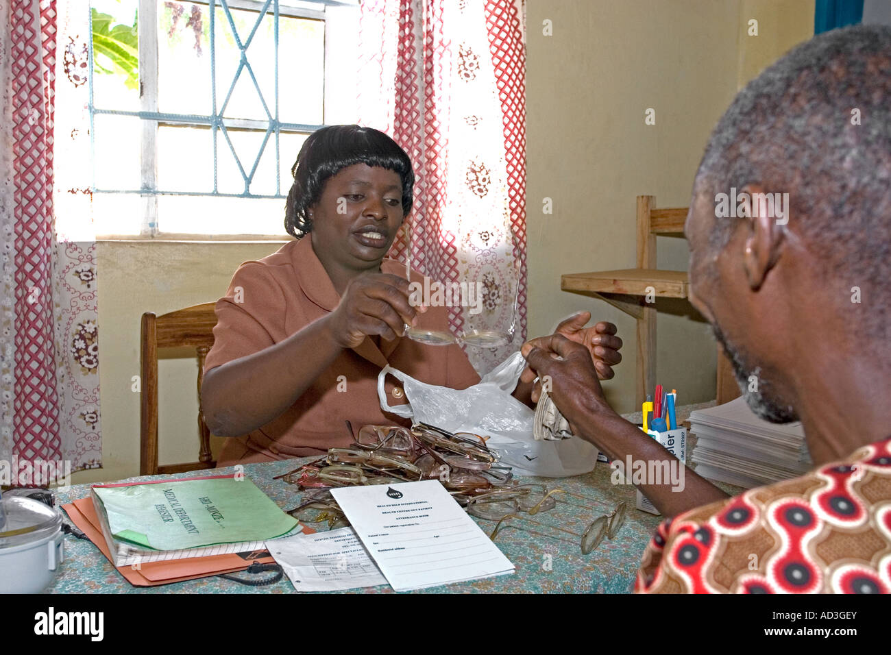 A nurse issues donated spectacles to a villager at UK charityHEALTH HELP INTERNATIONAL IN MONZE ZAMBIA Stock Photo