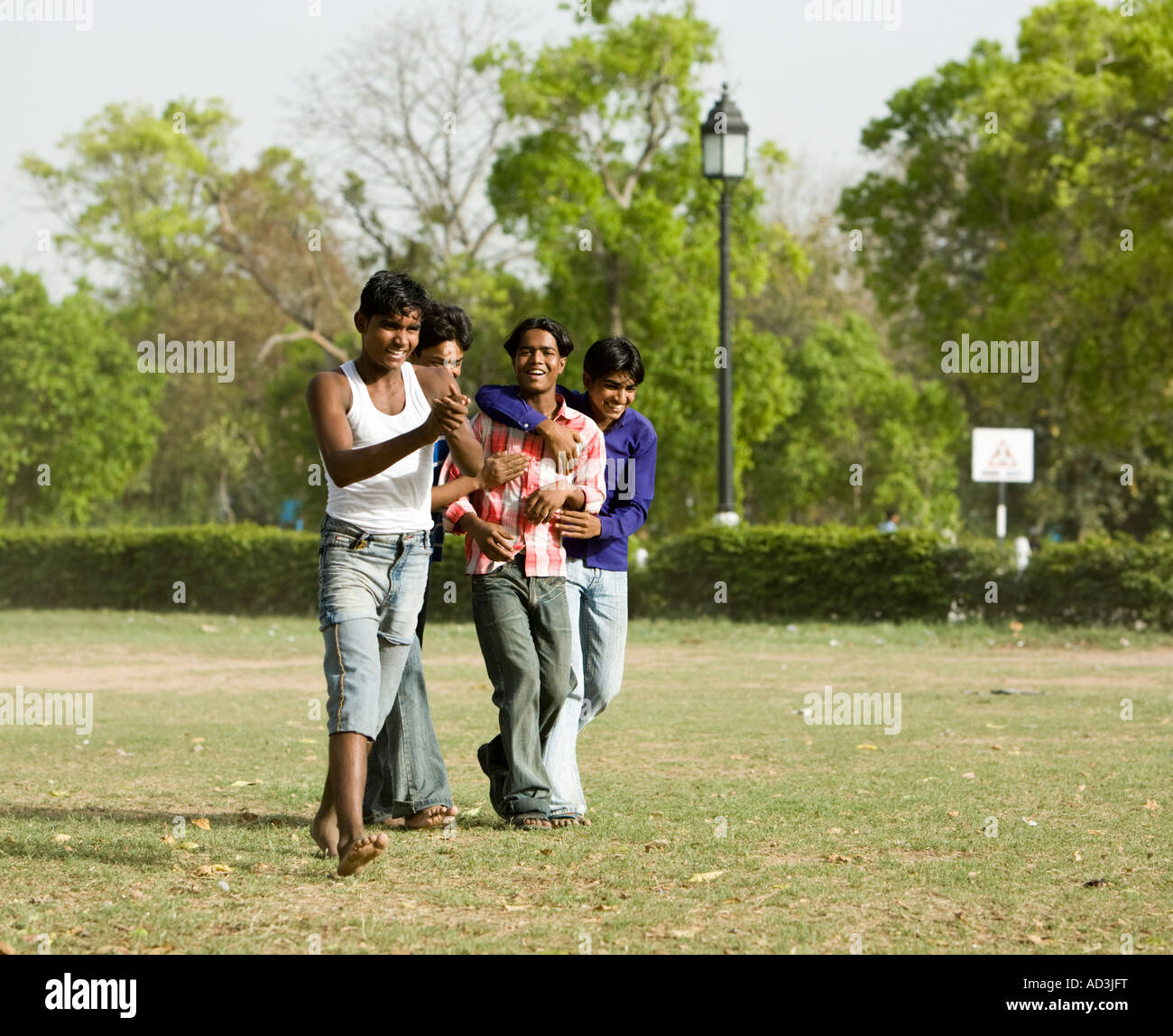 A group of friends celebrating Howzat! India Gate, New Delhi. - Stock Image