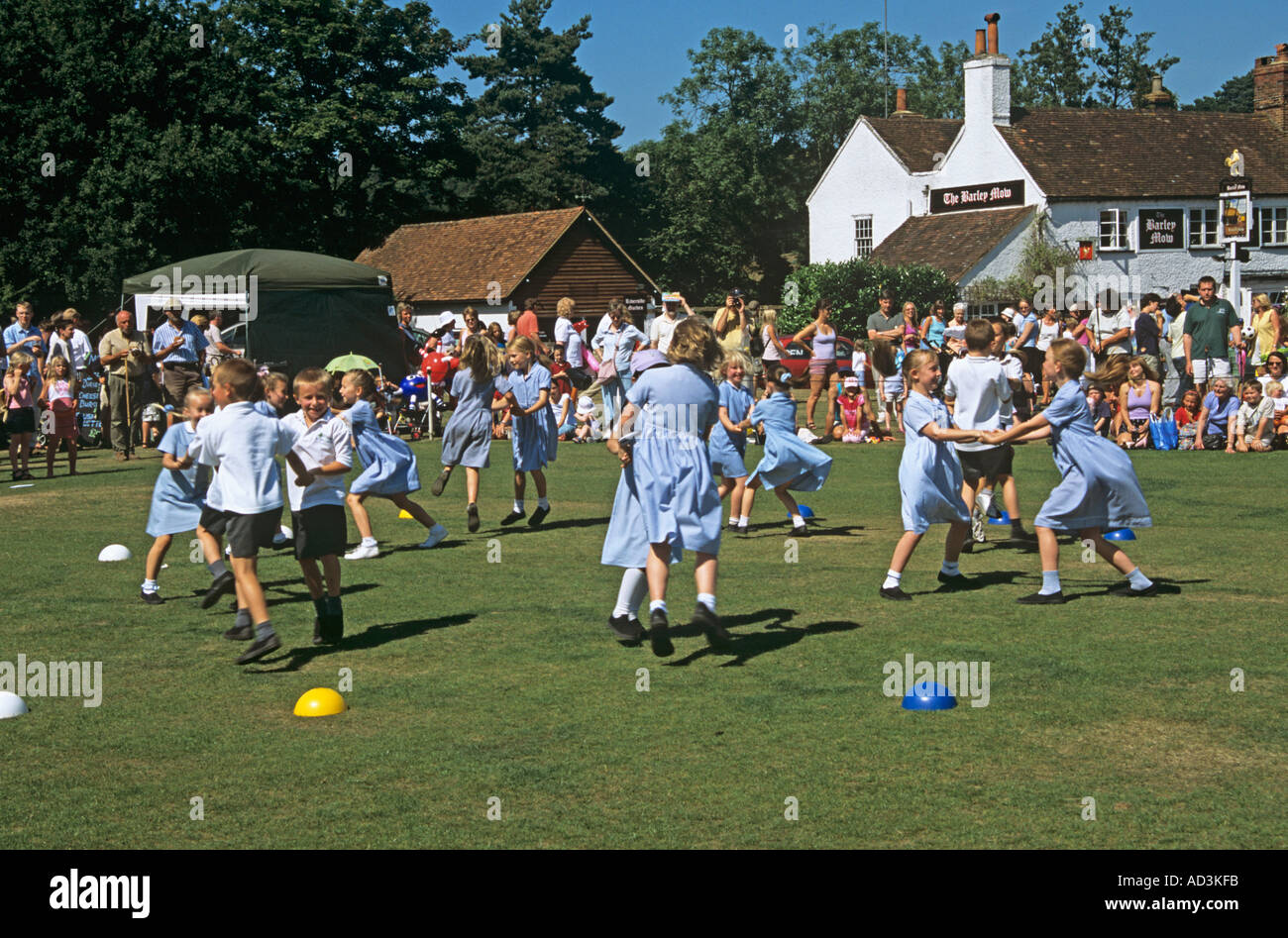 TILFORD SURREY UK July Primary school children entertaining the crowds with their country dancing - Stock Image