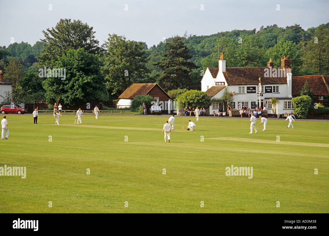 TILFORD SURREY England UK May Traditional game of cricket on the village green - Stock Image