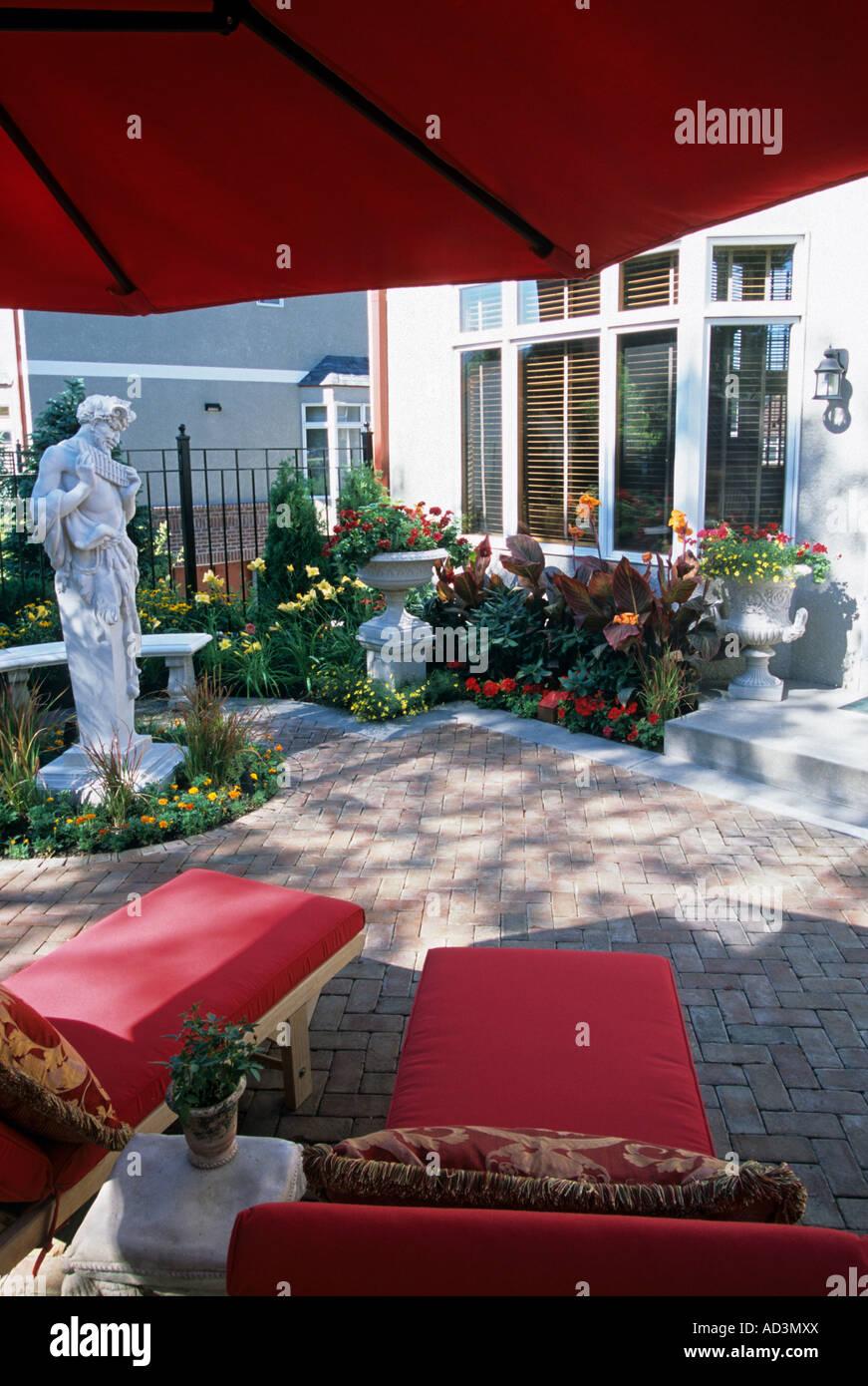 MINNEAPOLIS, MINNESOTA TOWNHOME PATIO GARDEN WITH STATUE OF PAN TERME,  HADDENSTONE BENCH, CANNA
