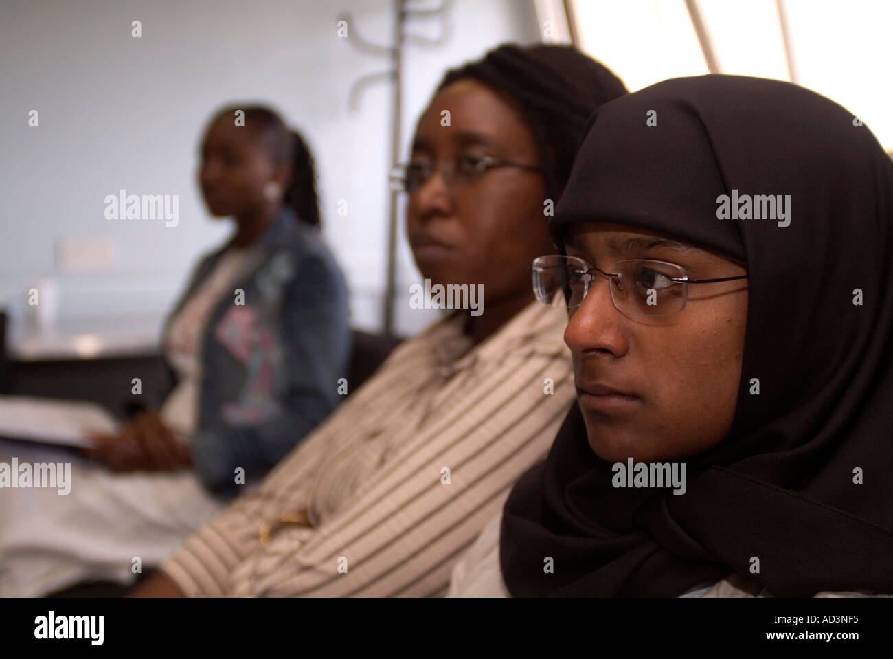Group of women at a conference for young teenage pregnant women London UK Stock Photo