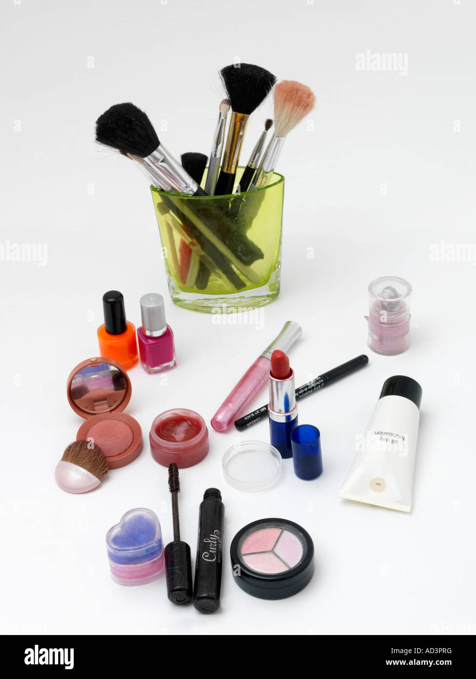 Collage of Common Make up Items including Foundation, Eye Shadow, Mascara, Blush, Lip Gloss - Stock Image