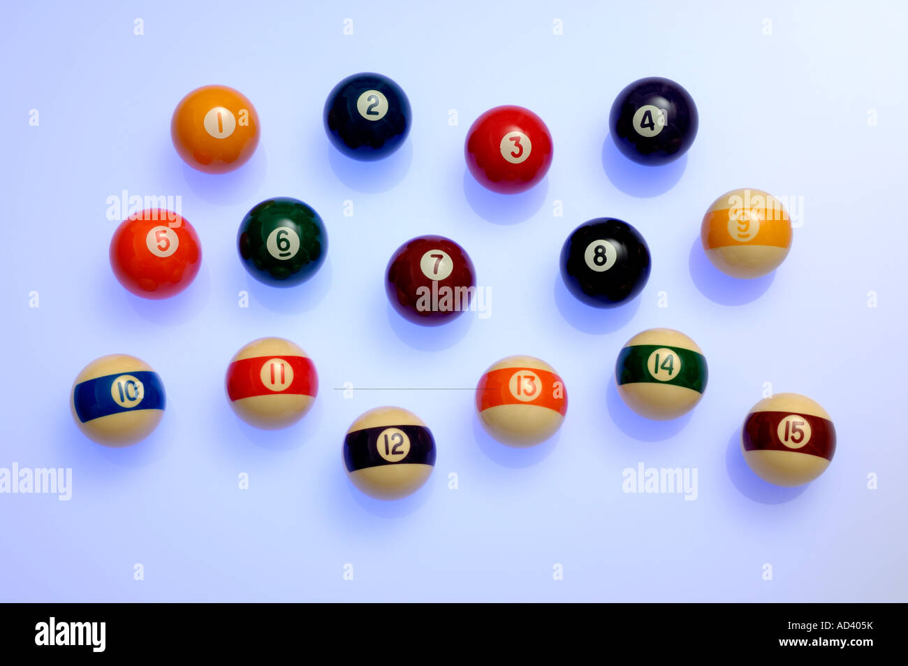 Pool balls numbered one to fifteen - Stock Image
