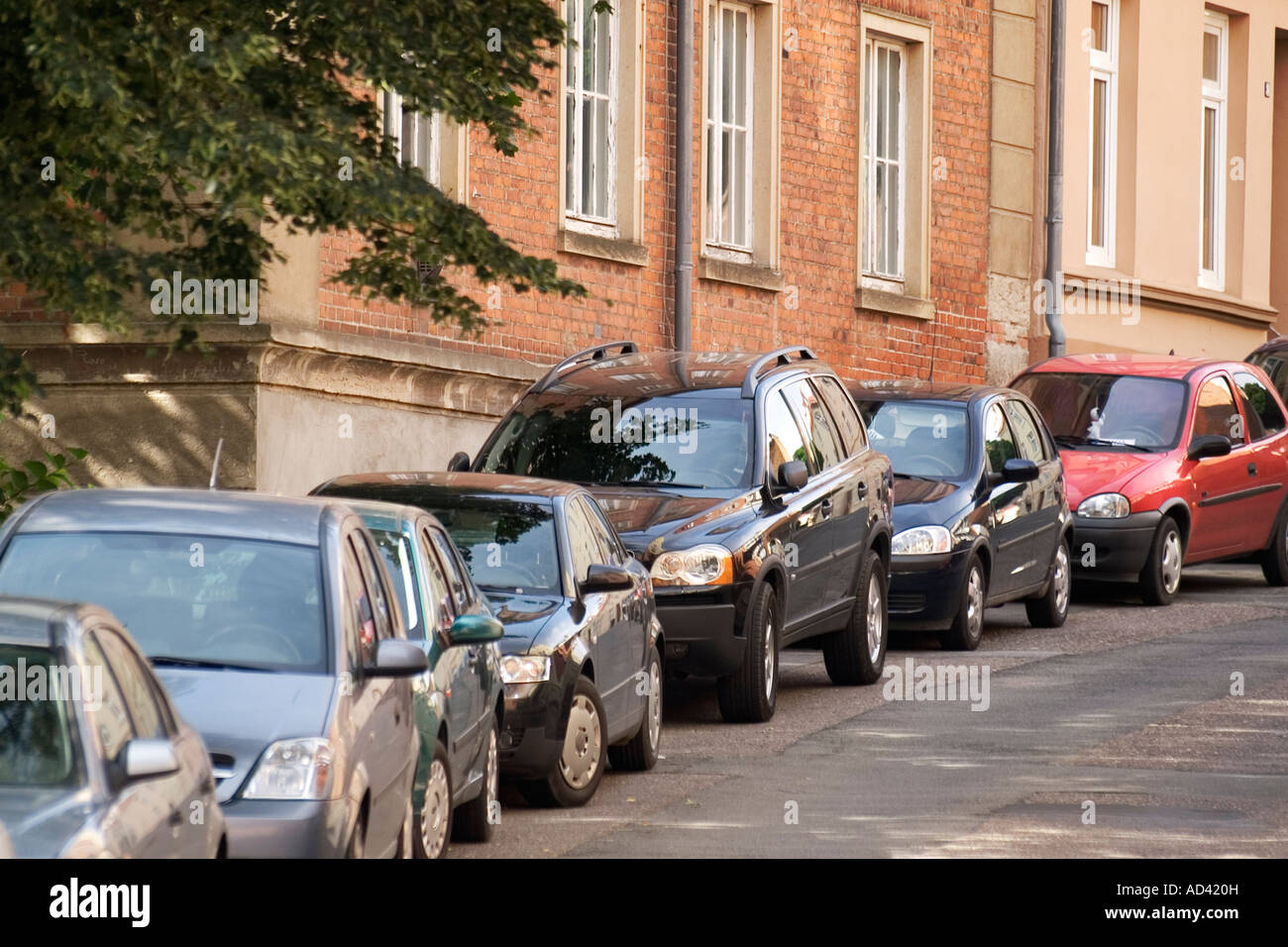 Parking row of cars in Wismar, Germany - Stock Image
