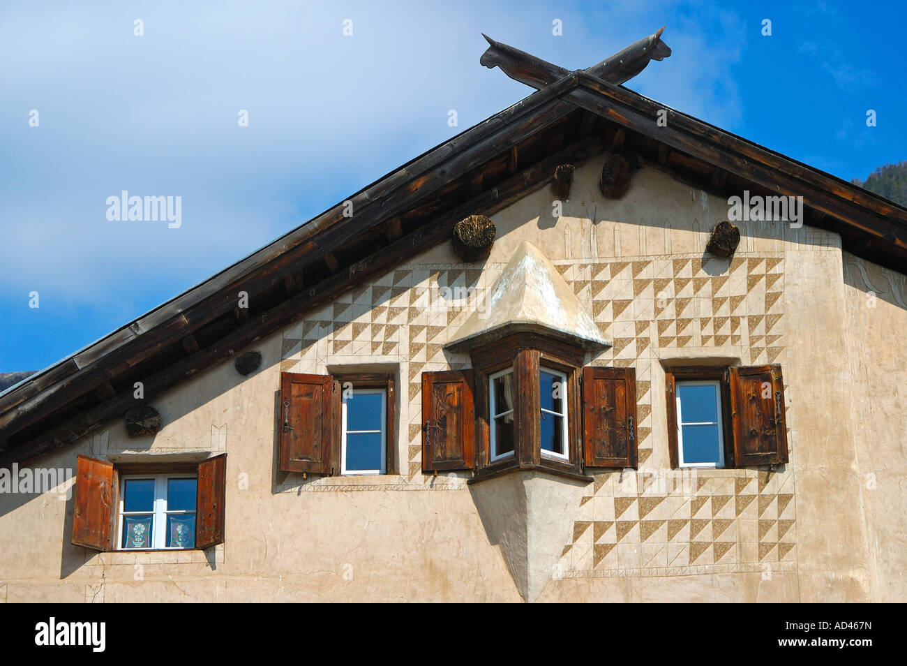Facade of a typical Engadine house decorated with Sgraffito ornaments, Samedan, Engadin, Grisons, Switzerland Stock Photo