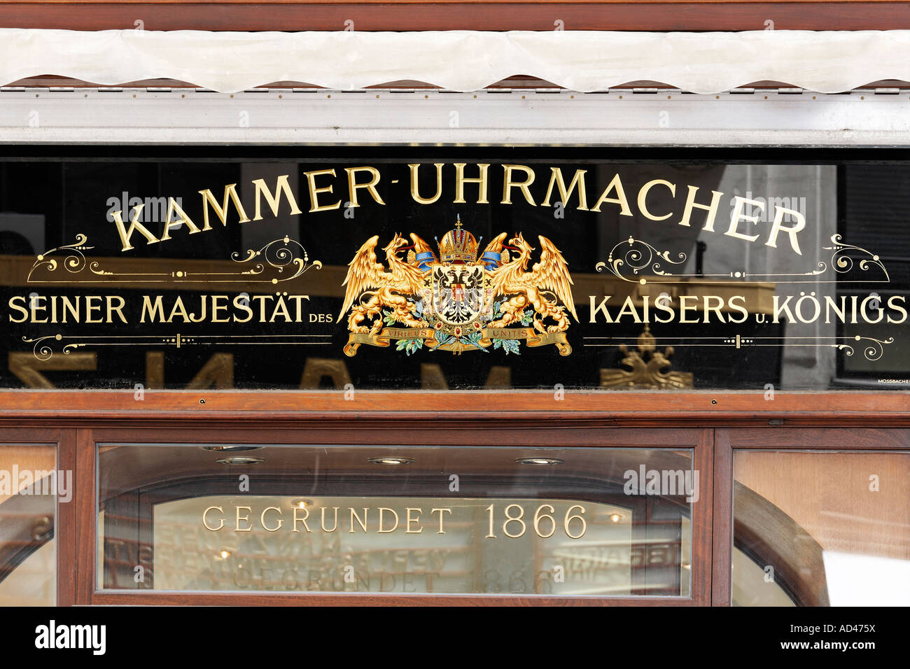 Ancient shop sign of a watchmaker from the K. u.K. period, Vienna, Austria - Stock Image