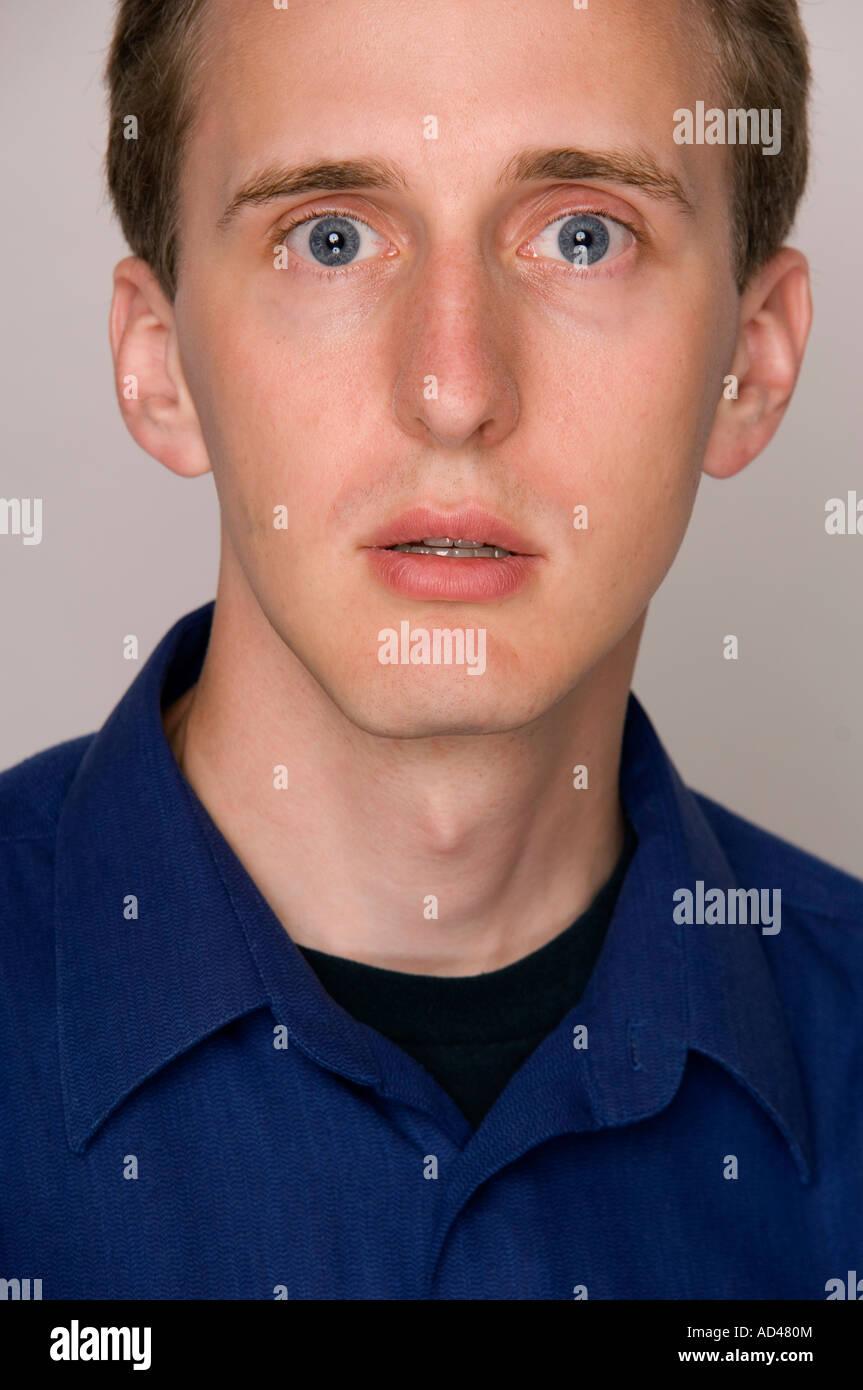 Dismayed man's face. - Stock Image