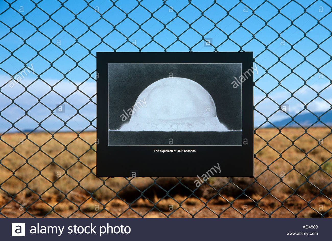 Engraved image of the Worlds first atomic bomb test located on the fence surounding the Trinity test site New Mexico - Stock Image