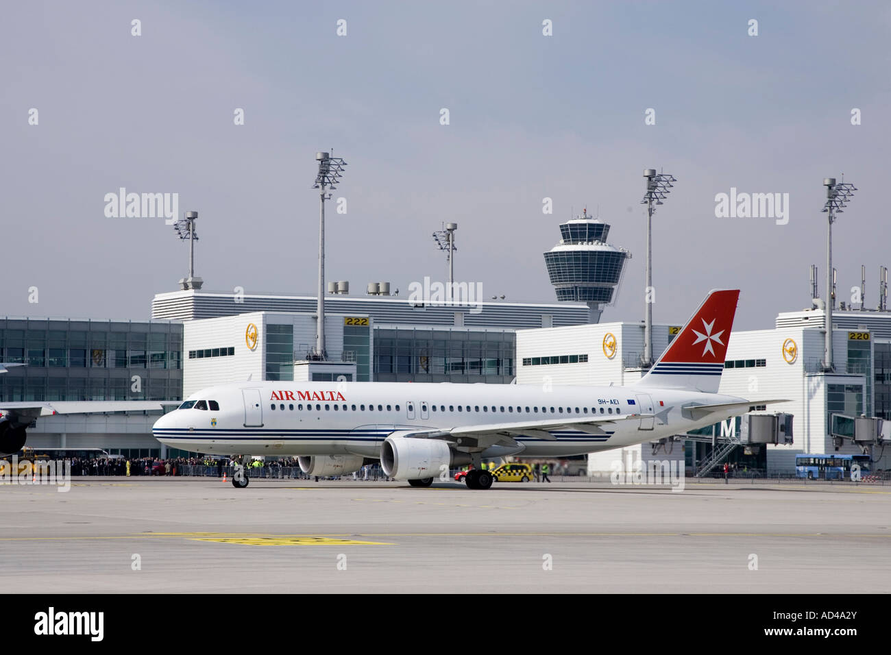 An Airbus A320 - 200 typed aircraft of Air Malta taxies at Munich Airport, Bavaria, Germany - Stock Image