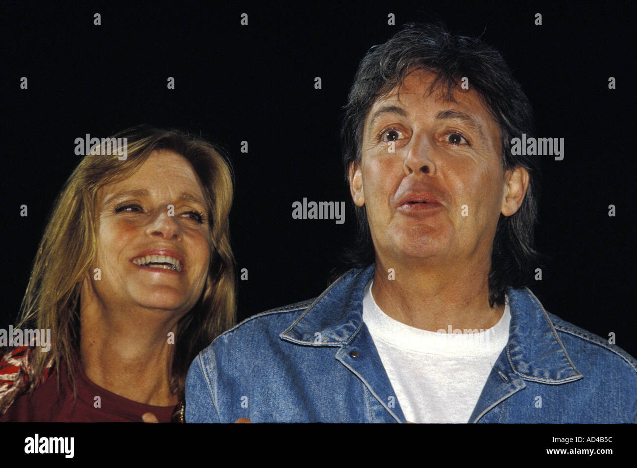 EX-BEATLE SINGER Sir Paul McCartney WITH LATE WIFE Linda McCartney performing in London,UK - Stock Image