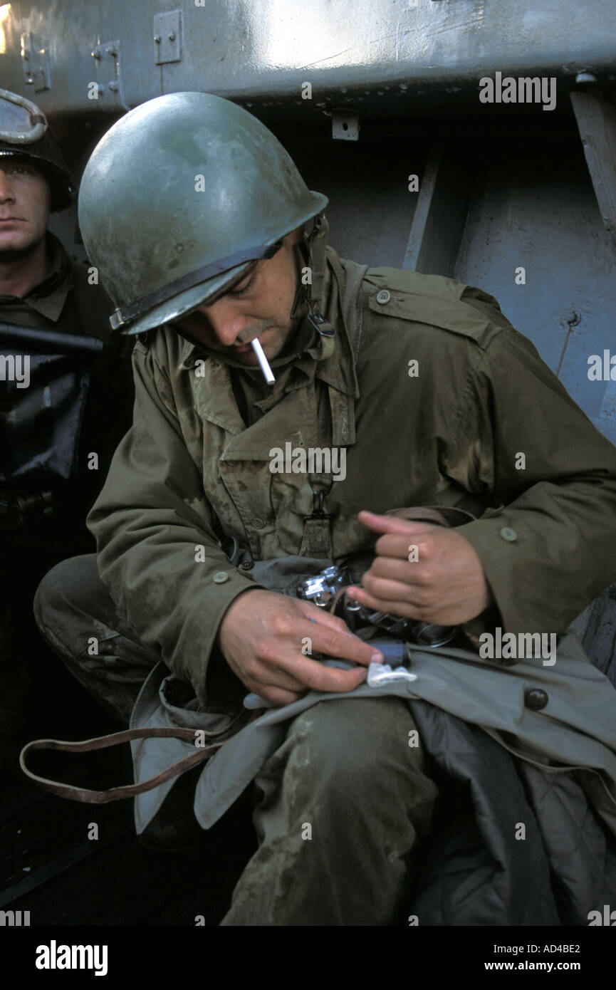 Playing famous war photographer Robert Capa at the landing crafts in Discovery Channel film: 'Return to Normandy' - Stock Image
