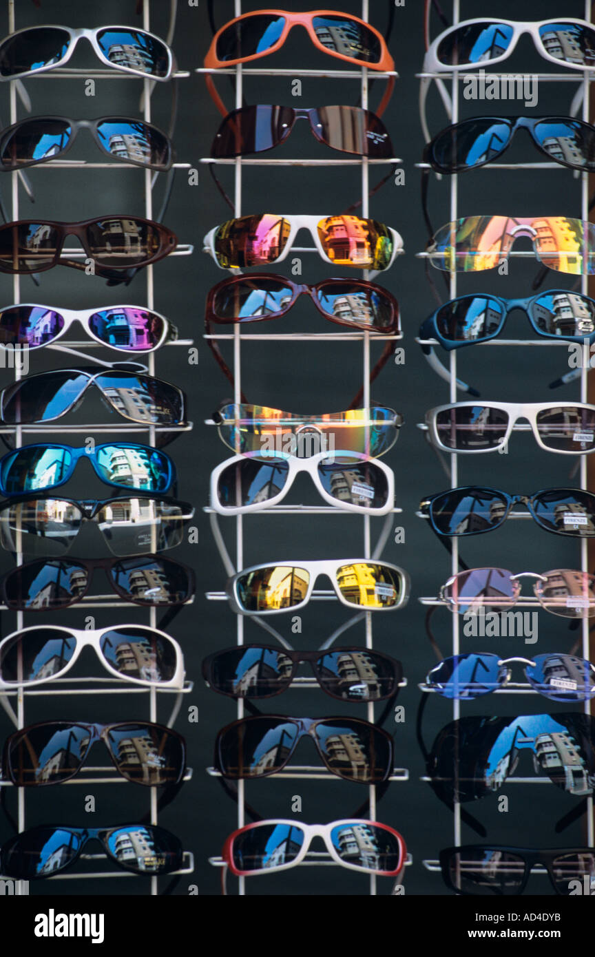 sunglasses for sale on rack / display stand outside of tourist shop in costa brava spain - Stock Image
