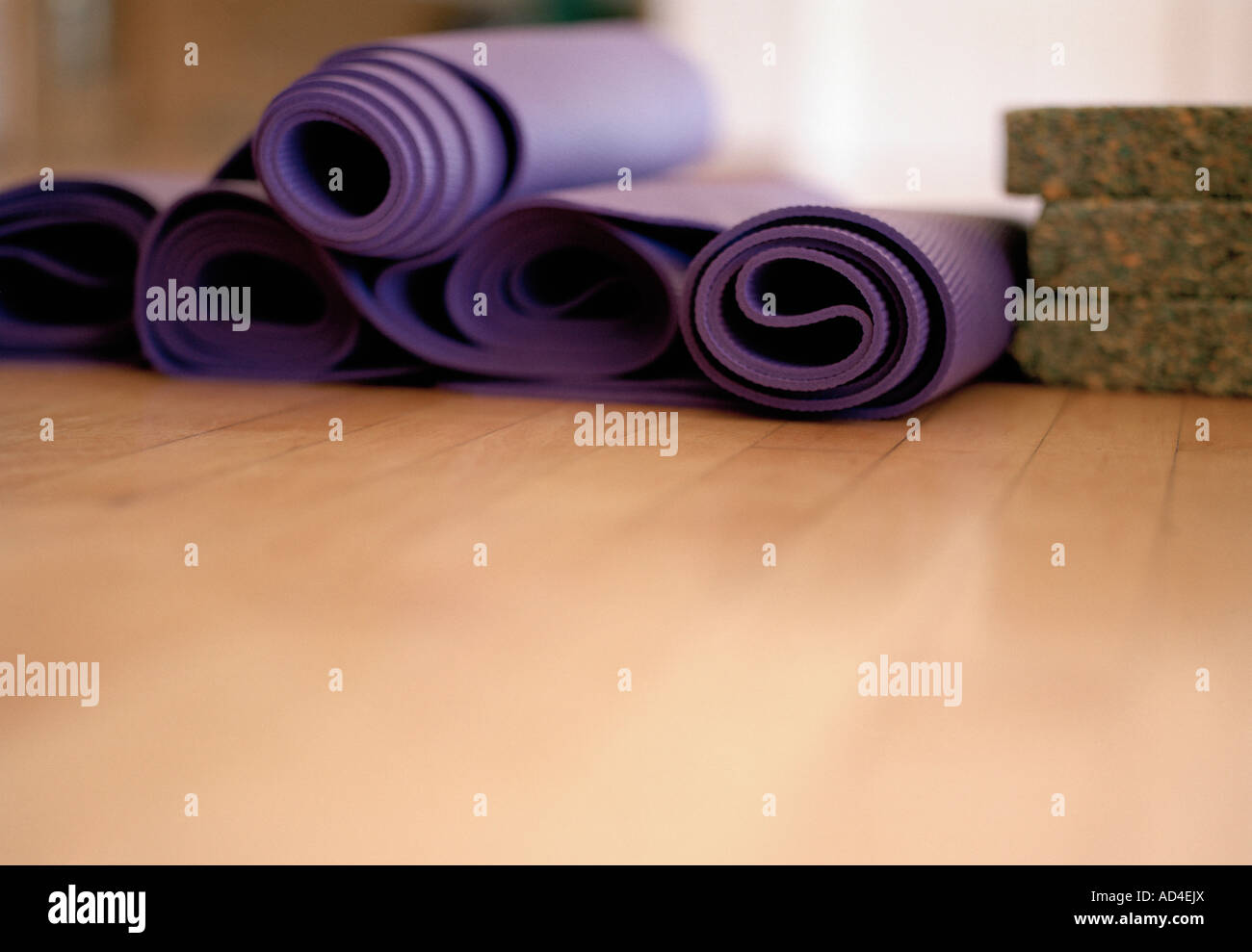 Exercise mats rolled up - Stock Image