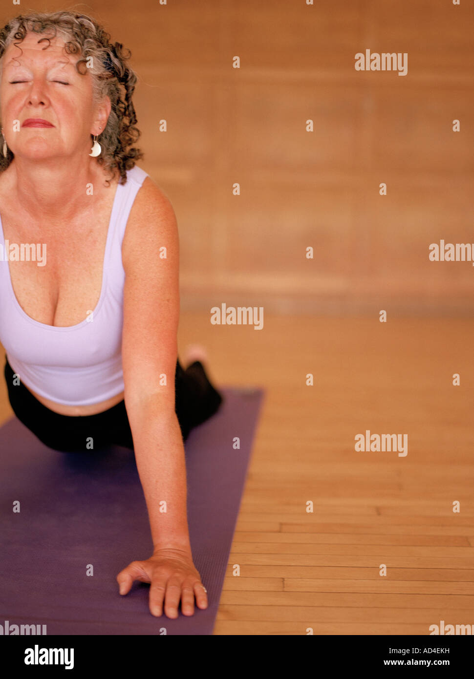 Woman in the cobra pose - Stock Image
