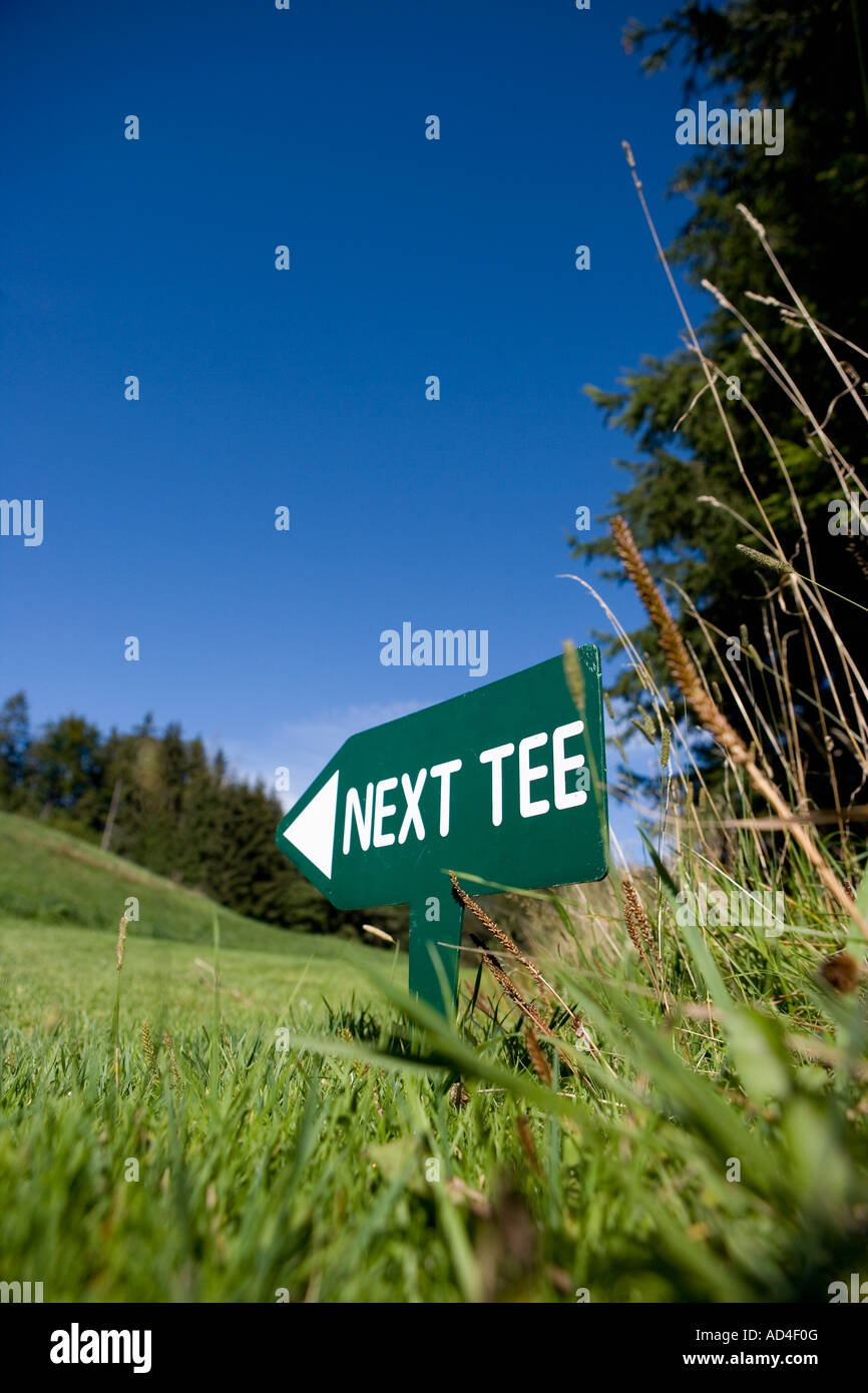 Sign for the 'Next Tee' on a golf course - Stock Image