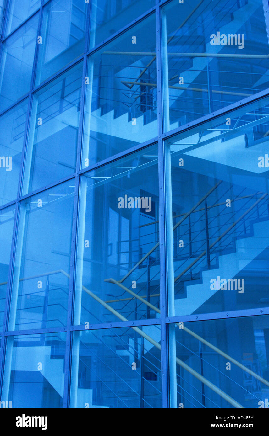 Glass facade and indoor stairwell - Stock Image