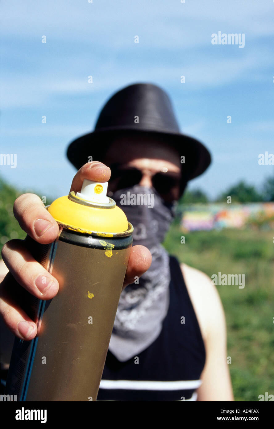 A man holding a can of spray paint - Stock Image