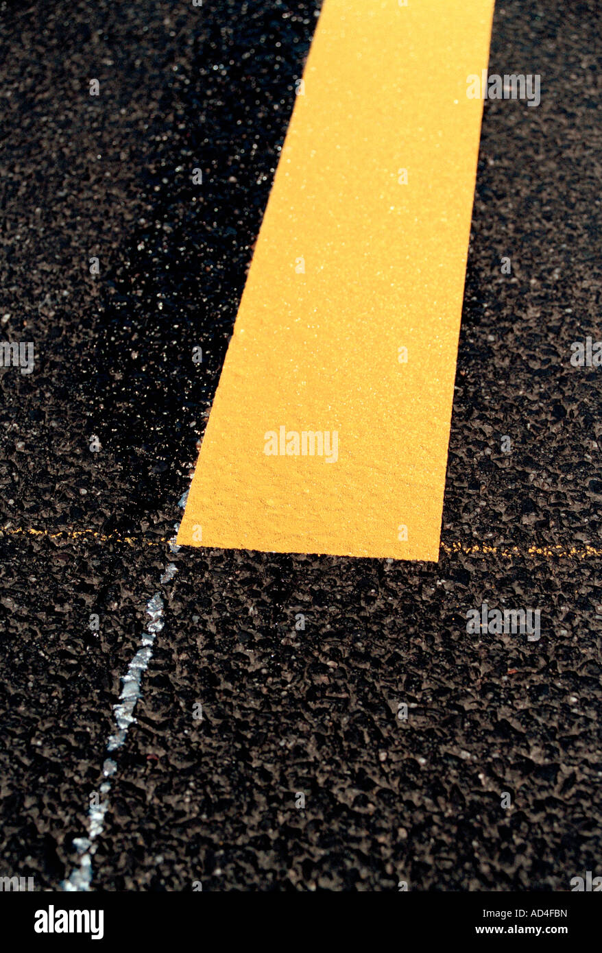 Detail of a yellow dividing line - Stock Image