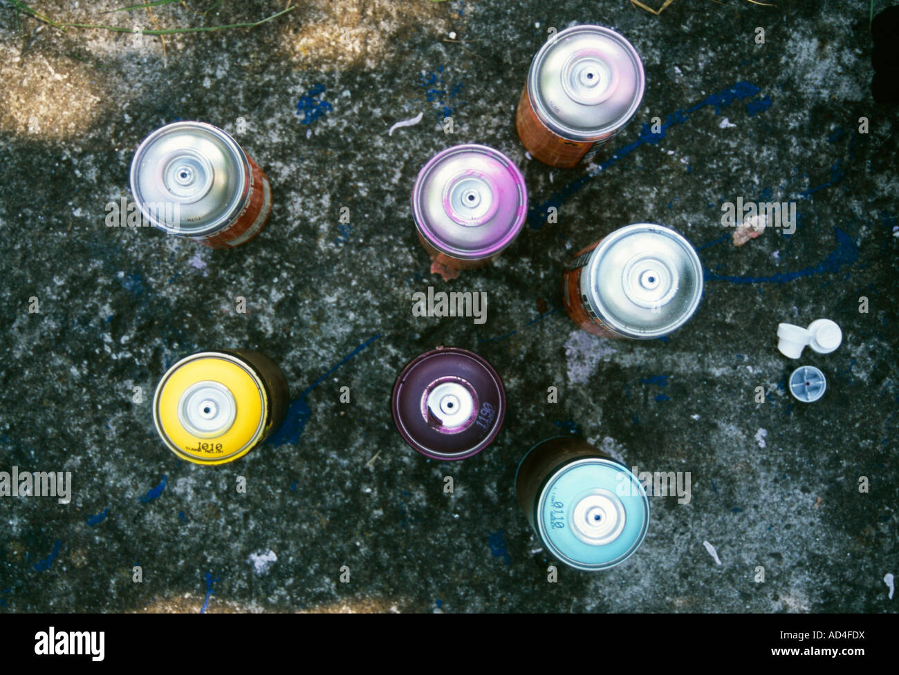 Cans of spray paint from above - Stock Image
