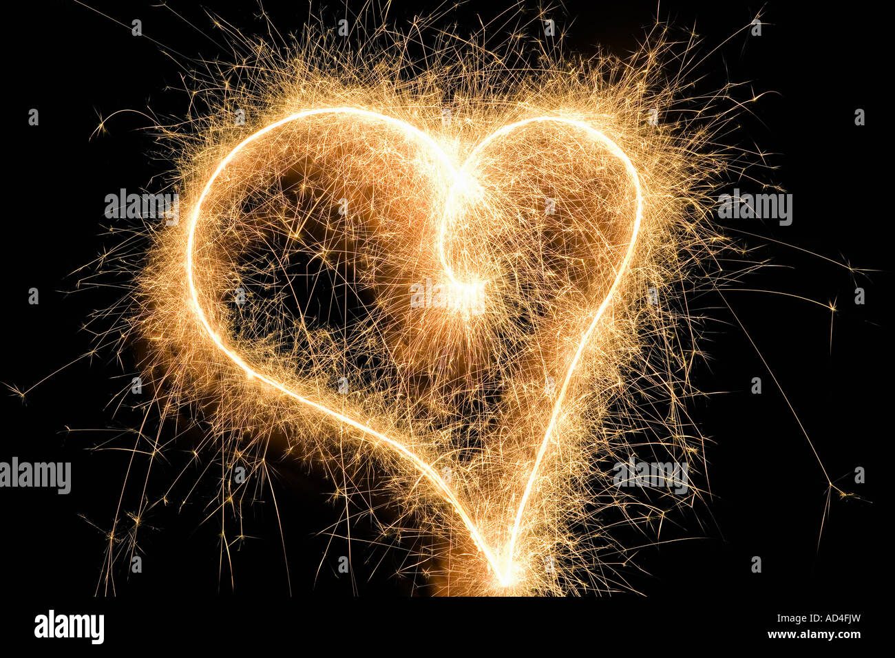 A heart shape drawn with a sparkler Stock Photo