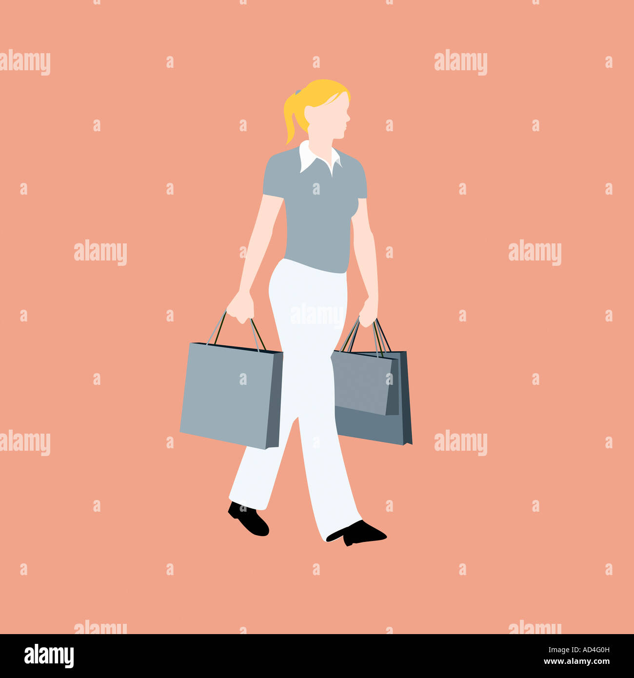 A woman walking with shopping bags - Stock Image