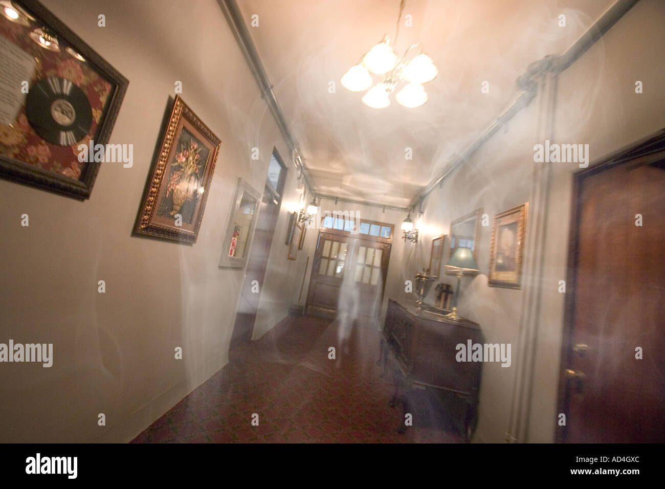 Two Ghosts in Hotel Hallway - Stock Image