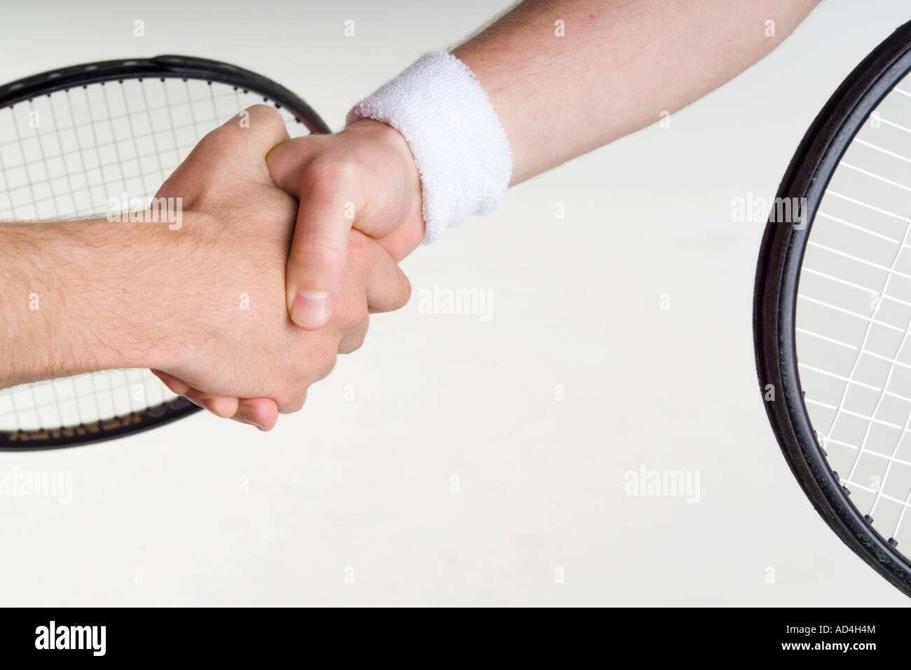 Two tennis players shaking hands - Stock Image
