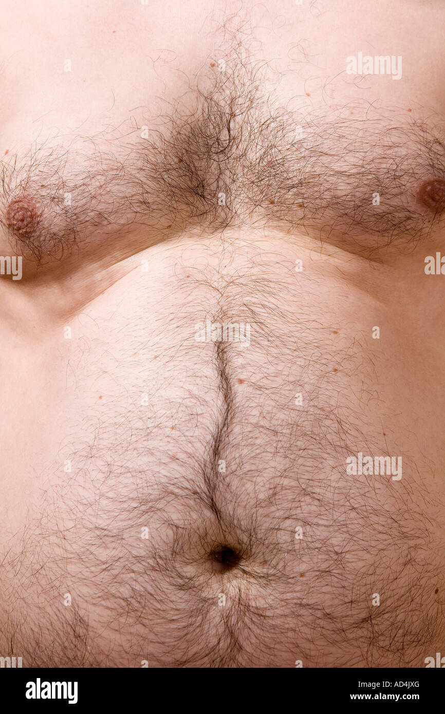 Midsection of a shirtless man - Stock Image