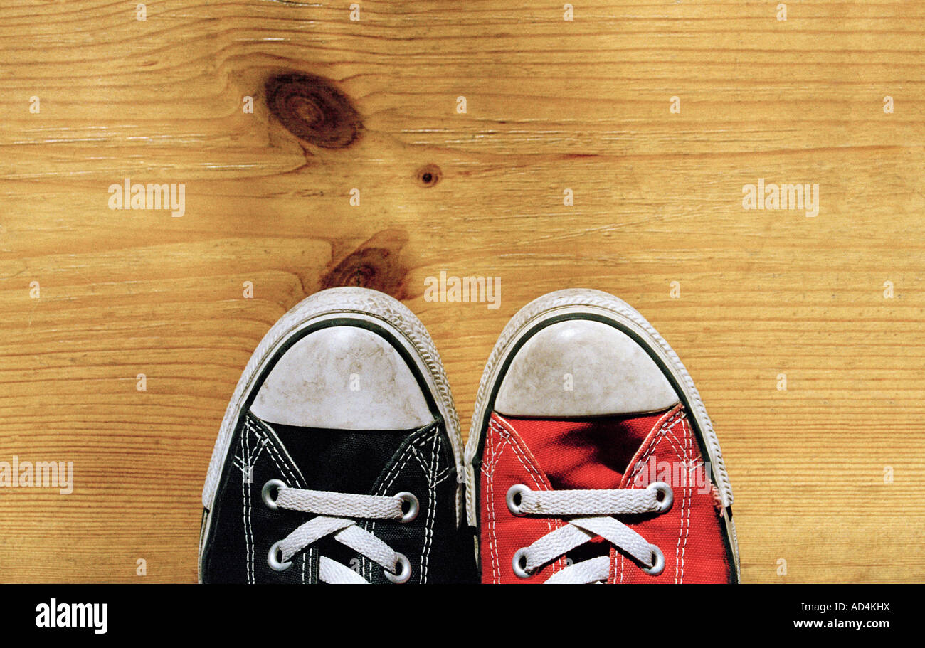 An odd pair of canvas shoes - Stock Image