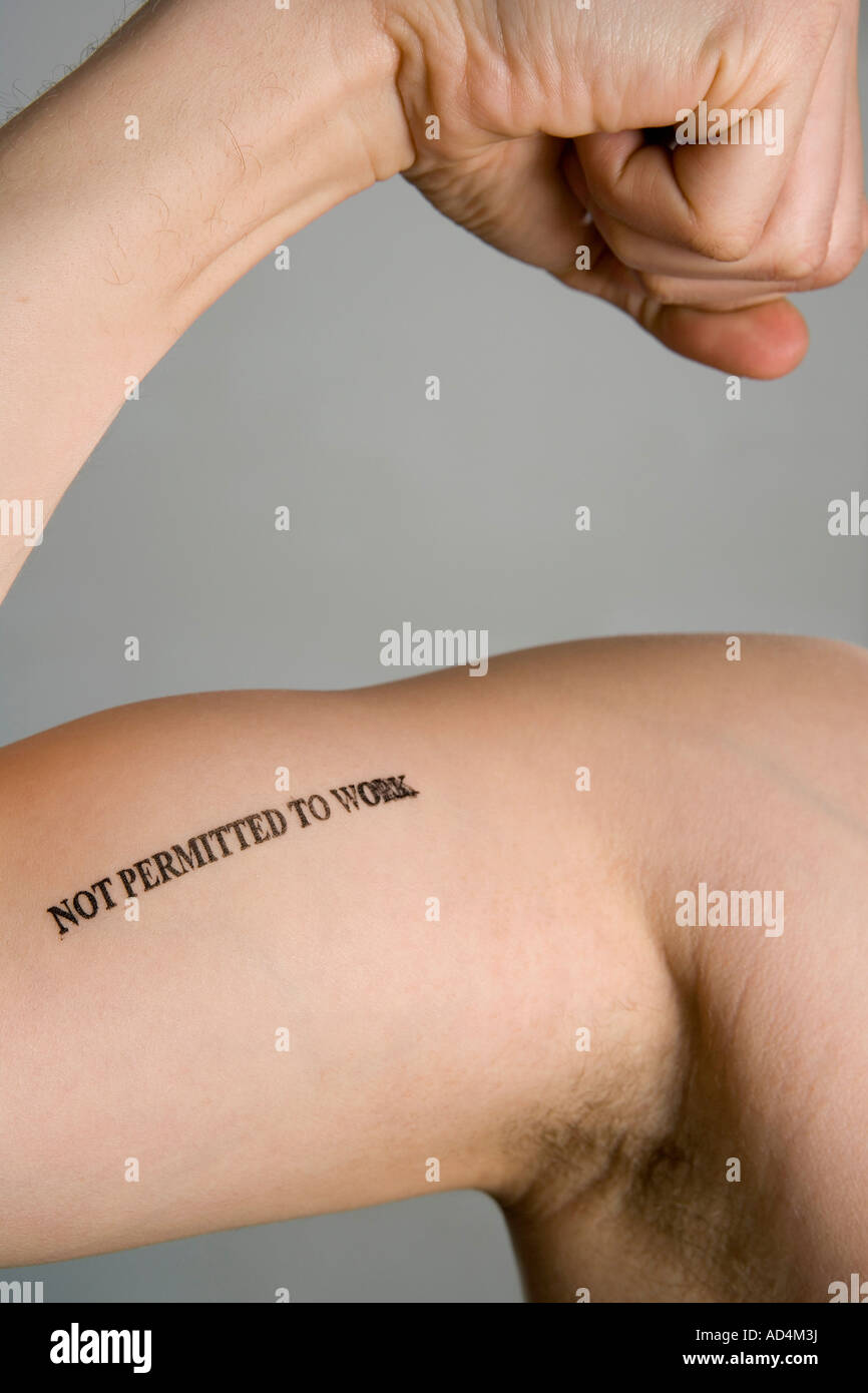 Detail of a man's bicep stamped 'Not permitted to work' - Stock Image
