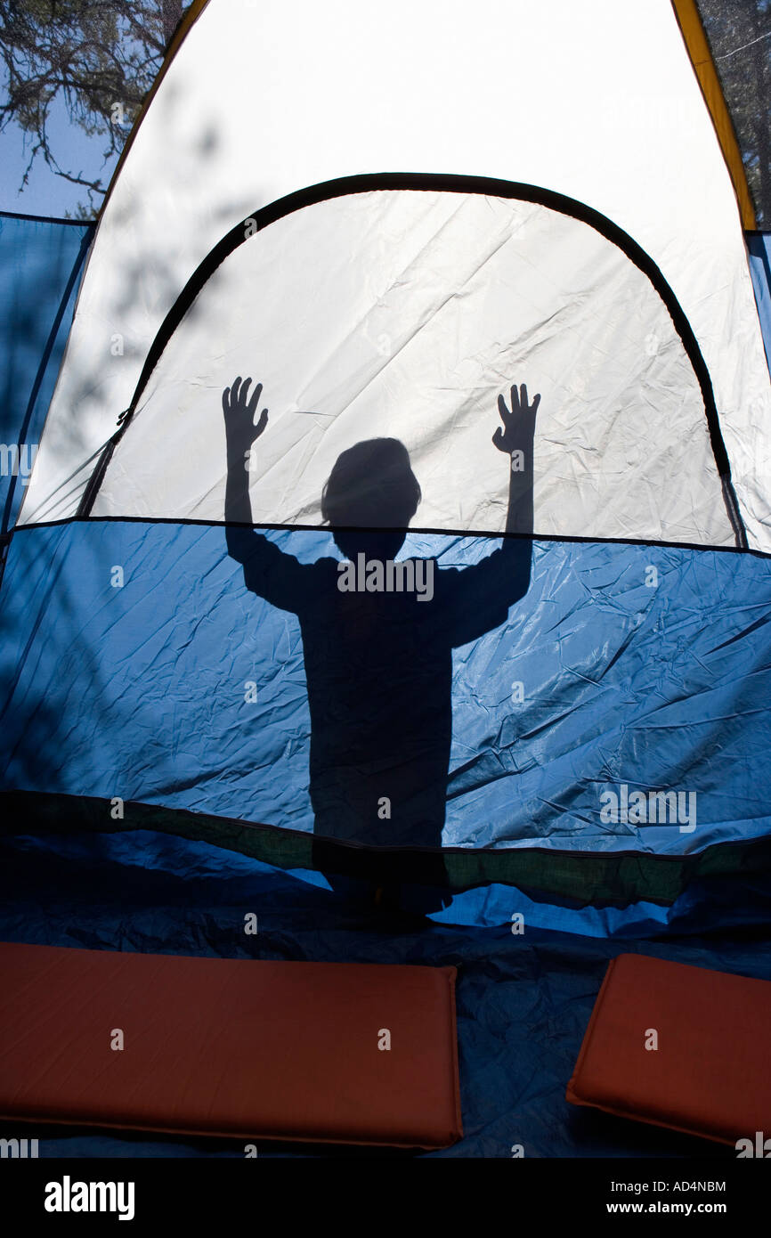 Shadow of a young boy behind a tent - Stock Image