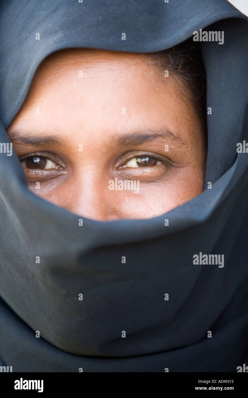 7602290 environmental portrait of young indian muslim woman stock
