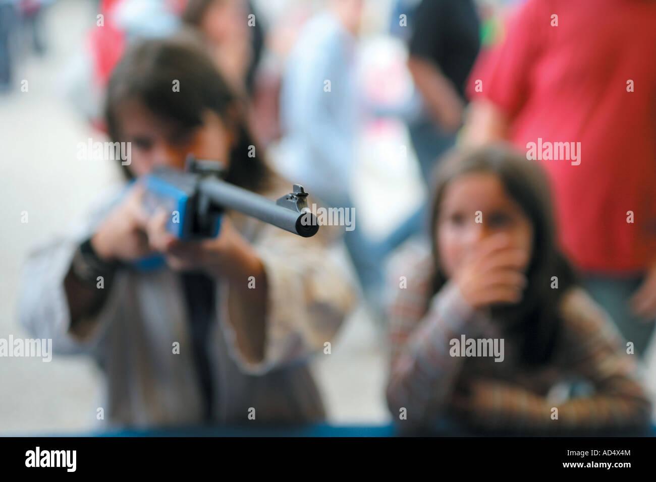 Girls Playing A Shooting Game Stock Photo Alamy