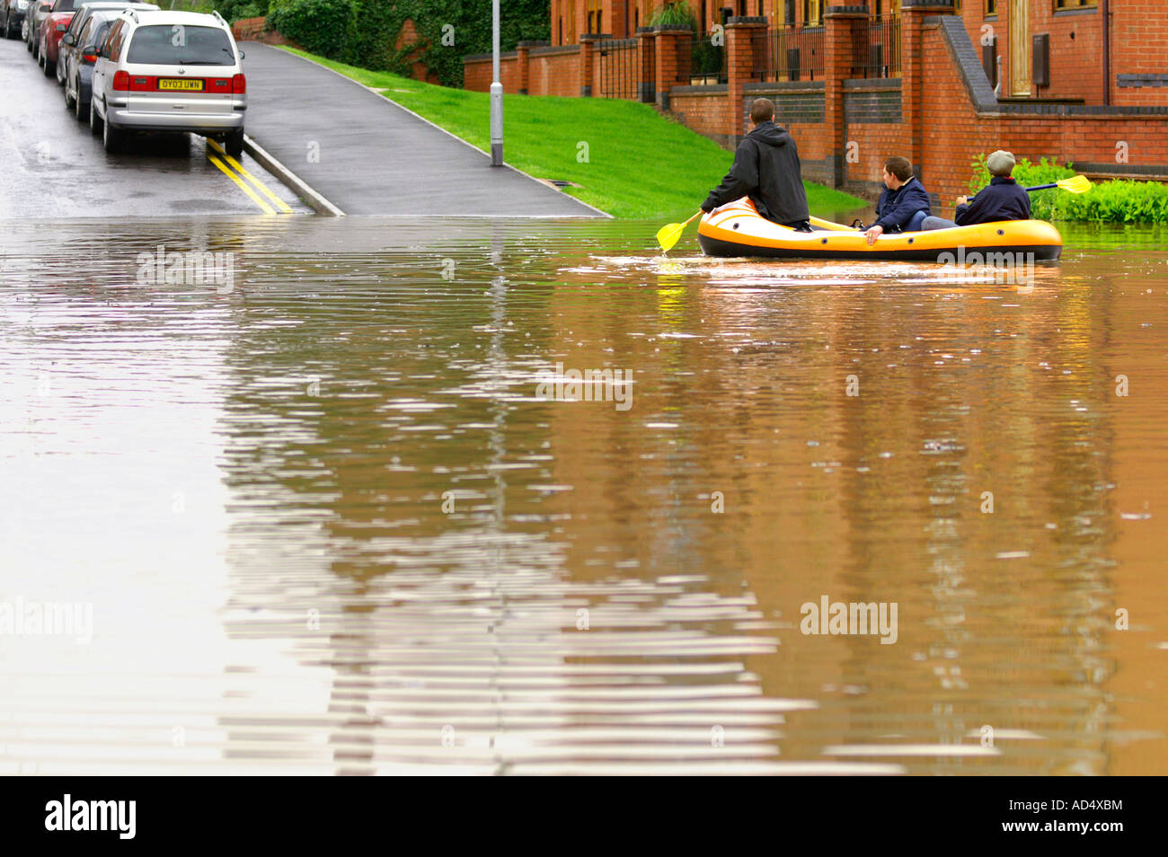 scared children on dinghy are looking for their lost parents during flood of the century. Somerset UK - Stock Image