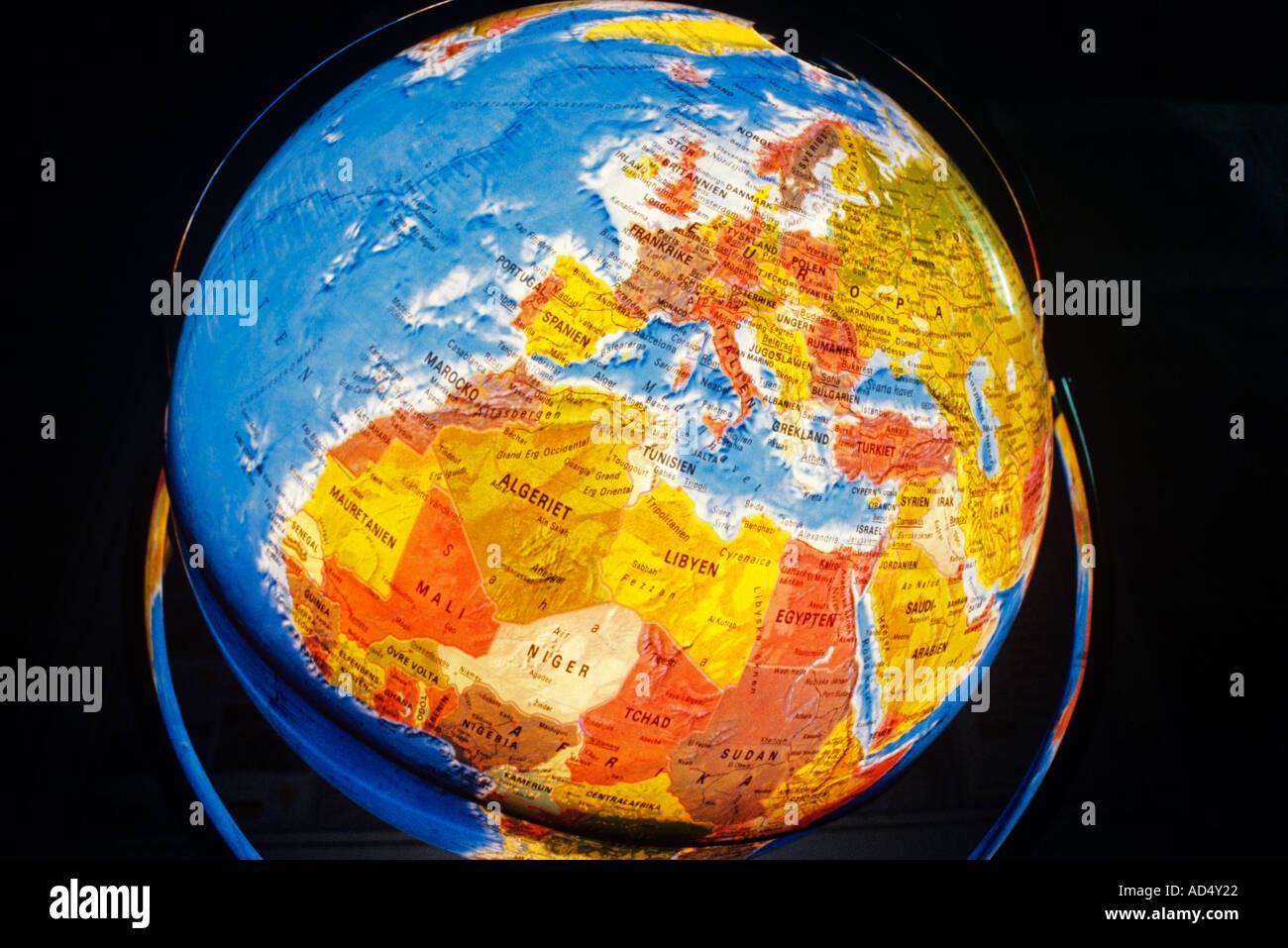 Swedish language illuminated world map globe - Stock Image