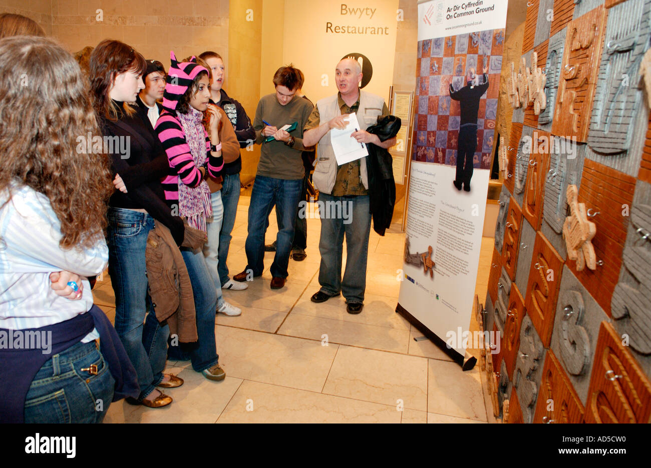 Visitors to National Museum Wales Cardiff look at an artwork they have made as part of a community project Stock Photo