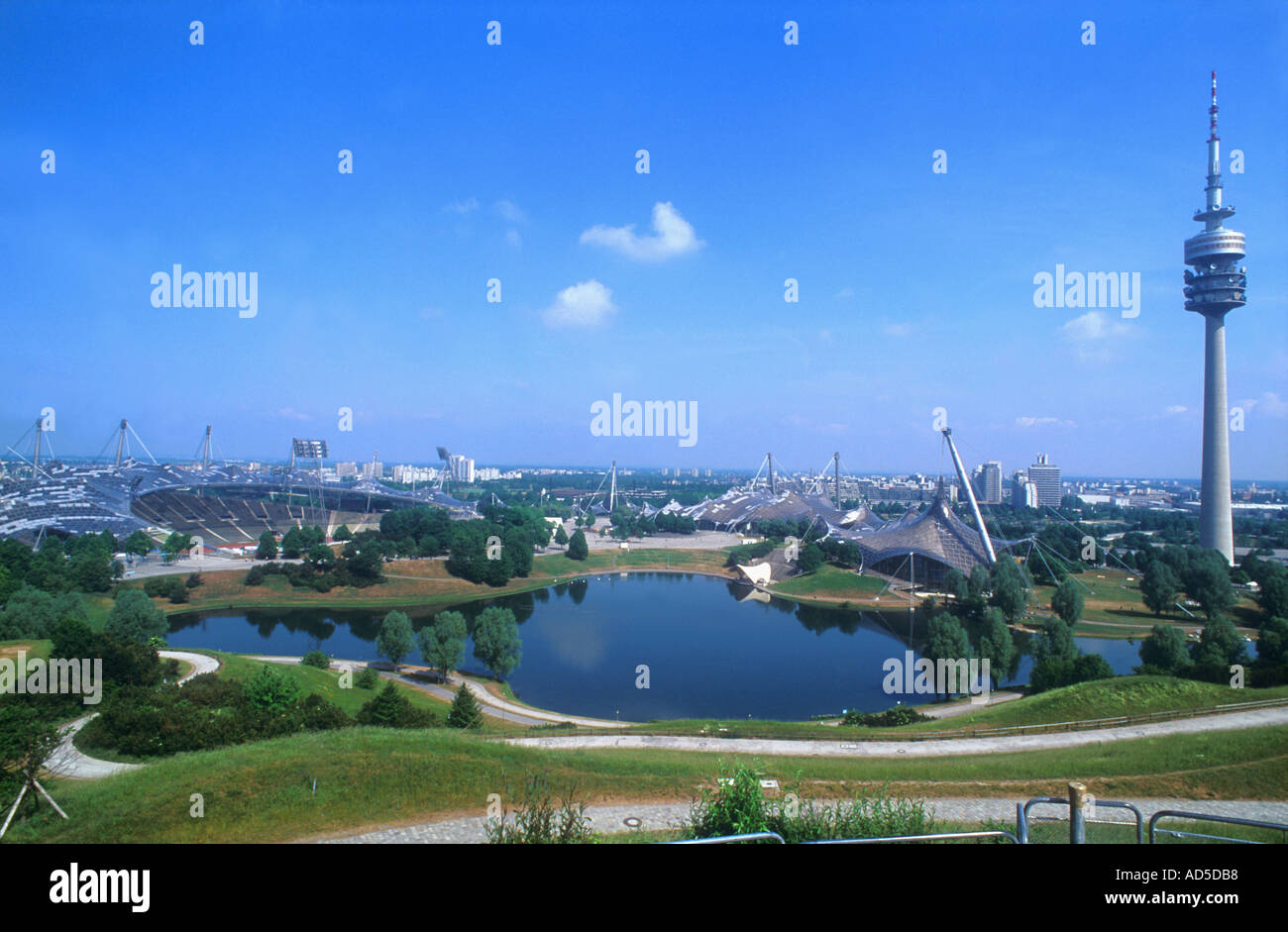 Panorama view of the Olympic Parc with Olympic Stadium lake Television Tower Munich Bavaria Germany Europe  - Stock Image