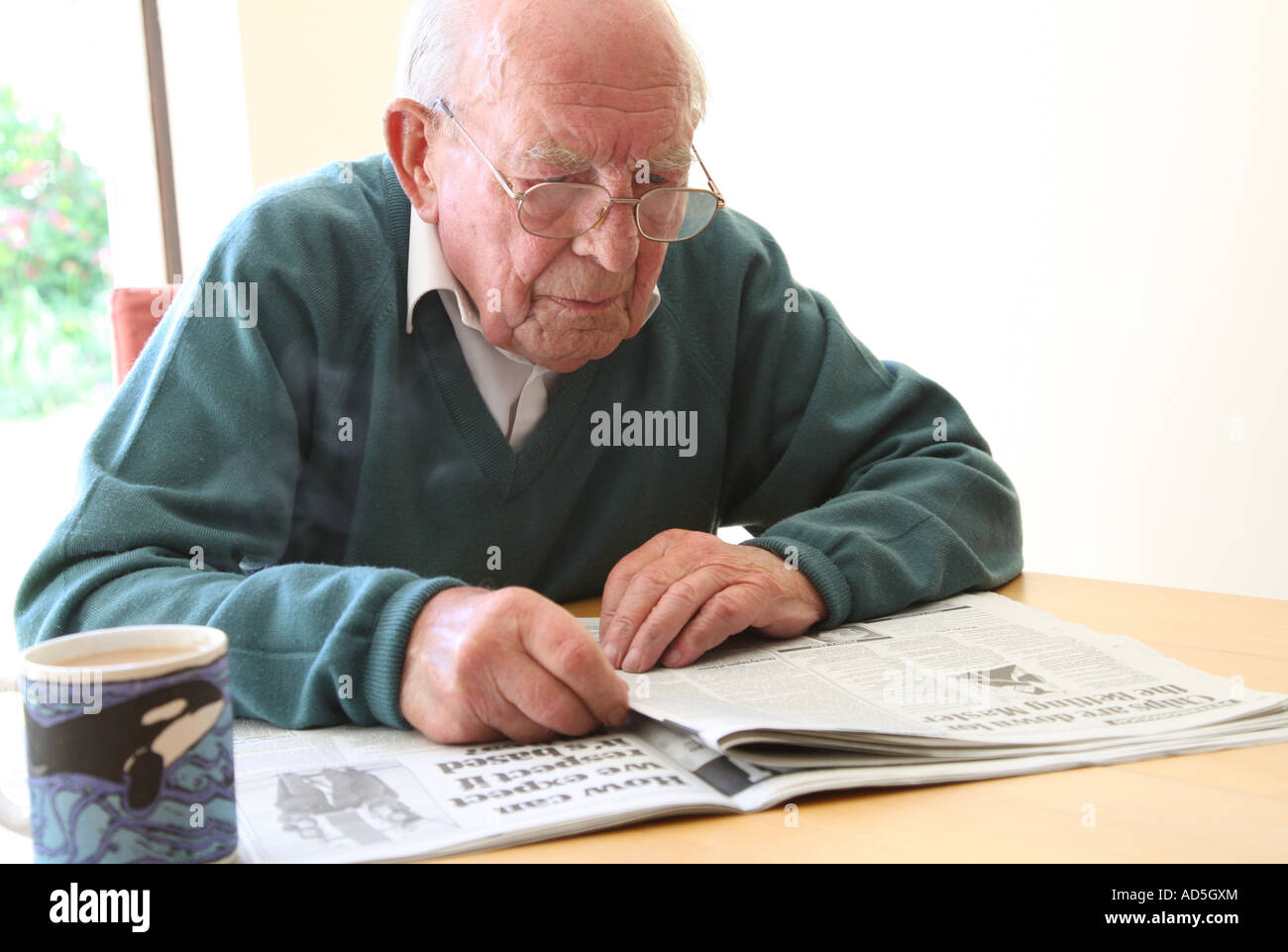 old man reading newspaper stock photo: 13311739 - alamy