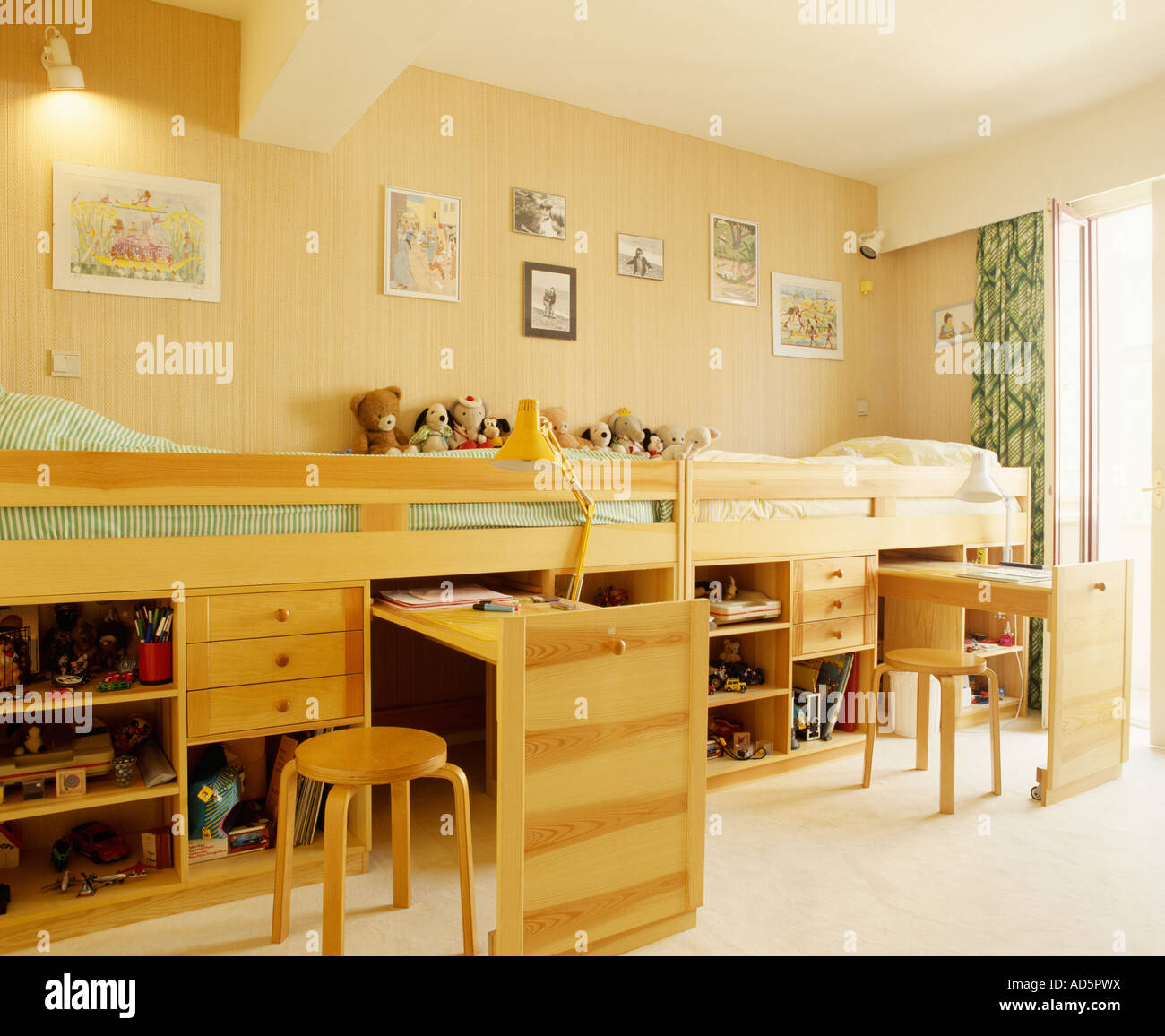 Picture of: Platform Beds With Pull Out Desks And Storage Below Stock Photo Alamy