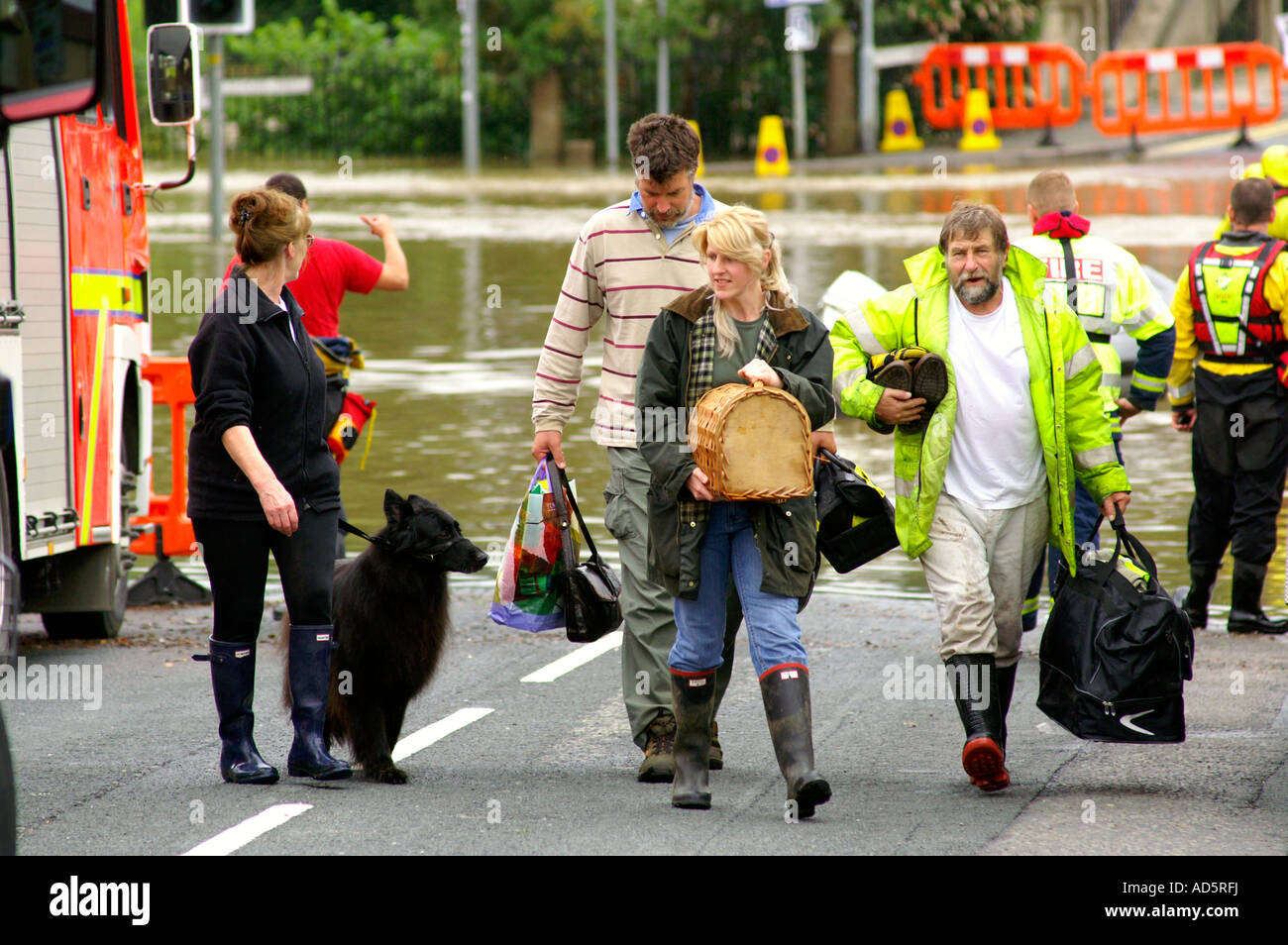 People and their pets being rescued after the flood of the century. England 2008 - Stock Image