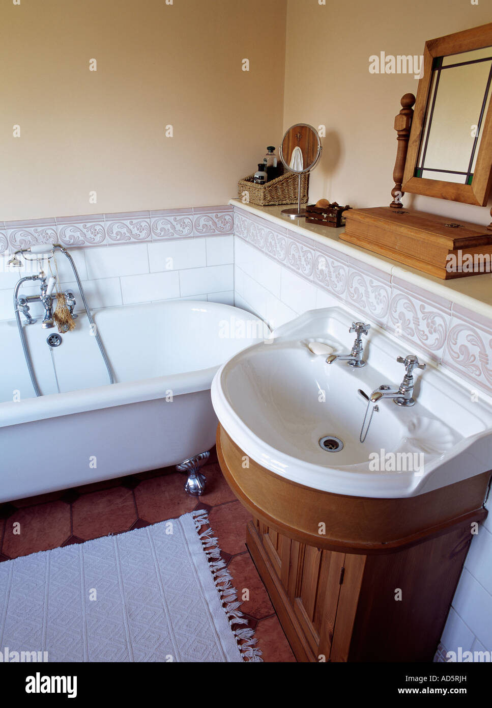 White raised pattern tiled border in bathroom with freestanding ...