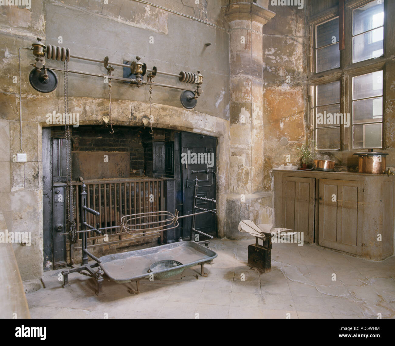 Large Oven And Cooking Racks In Old Country Kitchen With Stone Walls
