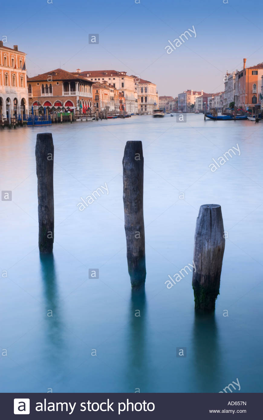 Mooring posts on the Grand Canal, Venice, Italy - Stock Image