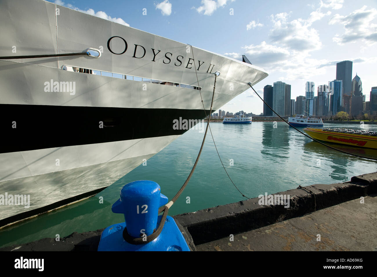 CHICAGO Illinois Odyssey cruise boat tied to dock at Navy Pier boat for cruises and parties tour boats and city - Stock Image