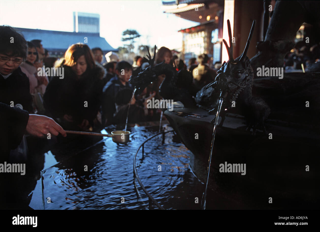 Cleansing hands in advance of prayers for New Year at The Sensoji Kannon Temple Tokyo Japan - Stock Image